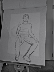 Still drawing, seated male