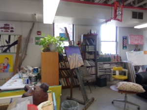 Other artist spaces include easels, shelves of books that are donated, even a handmade coat rack on which some artists have turned old canvases into lovely and unique purses.